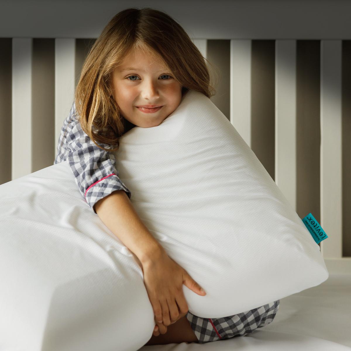 girl holding levitex pillow for neck pain