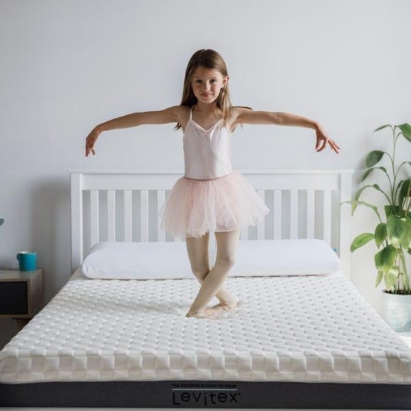child demonstrating the firmness of levitex foam