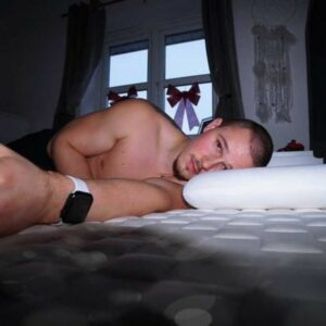 man lying on his side on his levitex bed