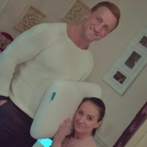 famous couple keith mason and riona kelly posing with a levitex in their bedroom